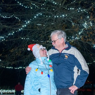 Couple Who Met While Volunteering Light the MetroTree